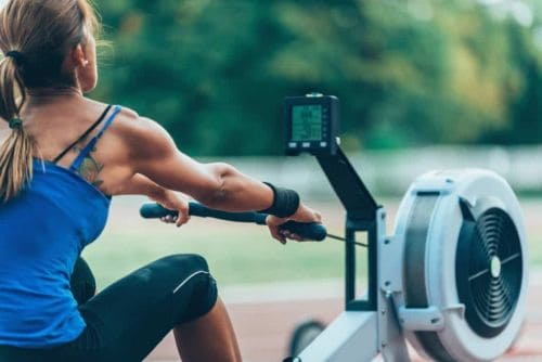 lady discovering what muscles does rowing build