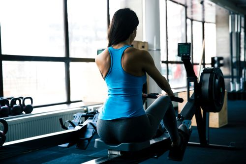 lady suffering from rowing machine lower back issues
