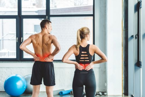 two people suffering from rowing lower back pain